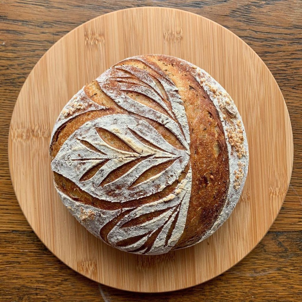 Bread No. 31 - a rosemary sourdough loaf baked at a lower temperature. Also, three leaves are better than two.